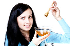 Girl holding honey bowl Royalty Free Stock Photo