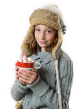 Girl holding hot chocolate. Pretty girl in a winter hat holding a mug of hot chocolate Royalty Free Stock Photo