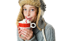 Girl holding hot chocolate. Pretty girl in a winter hat holding a mug of hot chocolate Royalty Free Stock Photos
