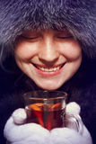 Girl holding a hot drink Stock Images
