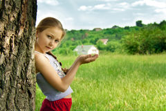 Girl holding a house Stock Photos