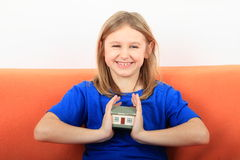 Girl holding a house Royalty Free Stock Photo
