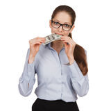 Girl holding a hundred dollar bill in his mouth Stock Images