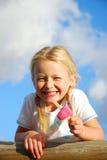 Girl holding ice-cream Royalty Free Stock Photography