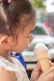 Girl holding ice cream cone. Royalty Free Stock Photo