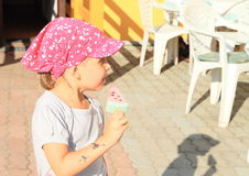 Girl holding ice-cream Stock Photos