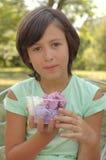 Girl holding ice cream tub Royalty Free Stock Image