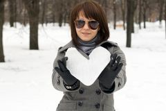 Girl holding an ice heart Royalty Free Stock Images