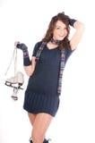Girl holding ice skates. Beautifully dressed girl holding ice skates, loves to skate Royalty Free Stock Photo
