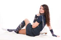 Girl holding ice skates. Beautifully dressed girl holding ice skates, loves to skate Stock Image