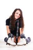 Girl holding ice skates Royalty Free Stock Photo