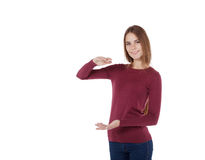 Girl holding an imaginary large board Stock Images