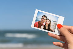 Girl Holding Instant Photo Of Happy Couple Royalty Free Stock Photos