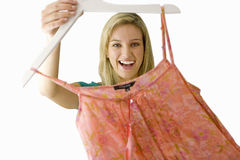 Girl holding item of clothing on hanger, cut out Royalty Free Stock Image