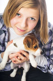 Girl holding Jack Russell Terrier puppy Stock Images