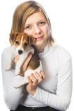 Girl holding Jack Russell Terrier puppy Stock Photo