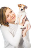 Girl holding Jack Russell Terrier puppy Royalty Free Stock Photos