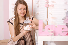 Girl holding a jar of marshmallow Stock Images