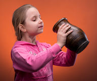 Girl holding a jar Royalty Free Stock Photos
