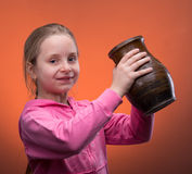 Girl holding a jar Stock Image