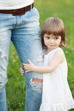 Girl holding on jeans Stock Photography