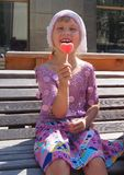 Girl holding jelly candy looks like the heart. Smiling girl holding jelly candy looks like the heart in summer day Stock Photos