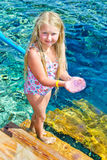 Girl holding a jellyfish Royalty Free Stock Photo