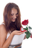 Girl holding jewellery gift box and flower. Royalty Free Stock Photography
