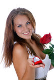 Girl holding jewellery gift box and flower. Royalty Free Stock Image