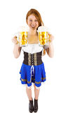 Girl holding jugs of beer Stock Photography