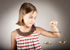 Girl holding justice scale Stock Photo