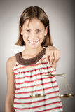 Girl holding justice scale Stock Images