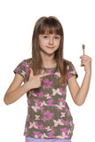 Girl holding a key to the apartment Stock Images