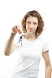 Girl holding keys Royalty Free Stock Image