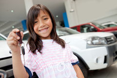 Girl holding keys of a car Stock Photography