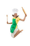 Girl holding kitchenware jumping Stock Images
