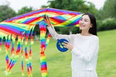 Girl holding a kite Royalty Free Stock Image