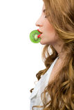 Girl holding a kiwi slice with the lips Royalty Free Stock Image