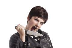 Girl holding knife Stock Photos