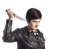 Girl holding knife Royalty Free Stock Photography