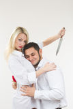 Girl holding knife traitor. man with rose in his hand. Girl holding knife traitor. men with rose in his hand. white background Royalty Free Stock Photography