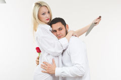 Girl holding knife traitor. man with rose in his hand. Girl holding knife traitor. men with rose in his hand. white background Stock Photo