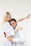 Girl holding knife traitor. man with rose in his hand. Royalty Free Stock Images