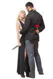 Girl holding knife traitor. man with rose in his. Girl holding a knife traitor. men with a rose in his hand. on a white background Stock Images