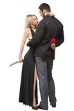 Girl holding knife traitor. man with rose in his. Girl holding a knife traitor. men with a rose in his hand. on a white background Stock Photo