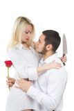 Girl holding knife traitor. man with rose in his. Girl holding a knife traitor. men with a rose in his hand. on a white background Royalty Free Stock Photos