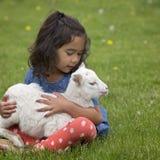 Girl holding lamb Stock Photo