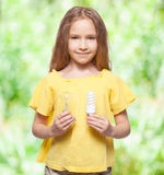Girl holding lamp Stock Image