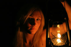 Girl holding lantern. A beautiful model holding a lantern in the dark Stock Photography