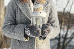 Girl holding lantern with a burning candle inside Royalty Free Stock Image
